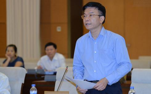 Bộ trưởng Bộ Tư pháp Lê Thành Long trình bày tờ trình dự thảo Luật Trách nhiệm bồi thường của Nhà nước (Ảnh: Quochoi.vn)
