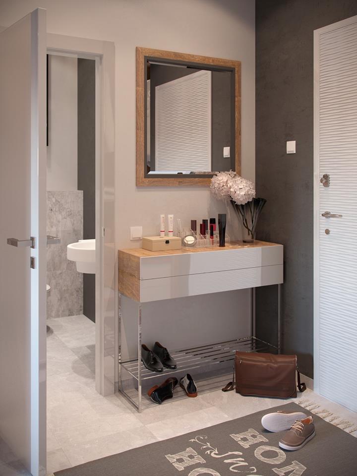 Ngay lối vào là khu vực vệ sinh nhỏ và giá để giày dép gọn gàng. Phía trên là chiếc gương giúp chủ nhà sửa soạn quần áo mỗi khi ra ngoài.