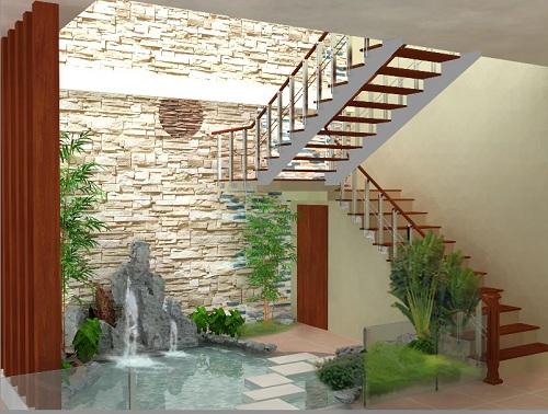 Khu vực giếng trời nơi góc nhà sẽ trở nên vô cùng sinh động với cây xanh và hồ nước.