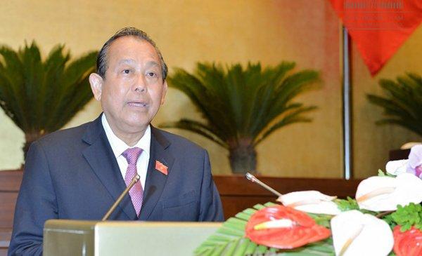 Phó Thủ tướng thường trực Trương Hoà Bình trình bày báo của Chính phủ trước QH