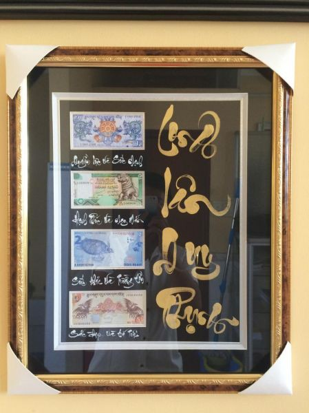 Khung tranh tiền Tứ Linh Long Lân Quy Phụng có giá 380.000 đồng.