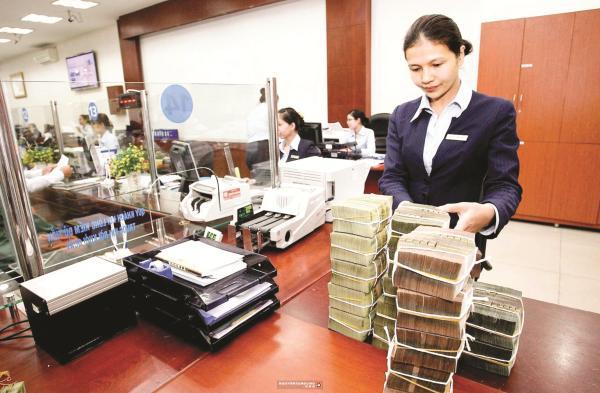 Cần giải pháp quyết liệt với các ngân hàng yếu kém - ảnh 1