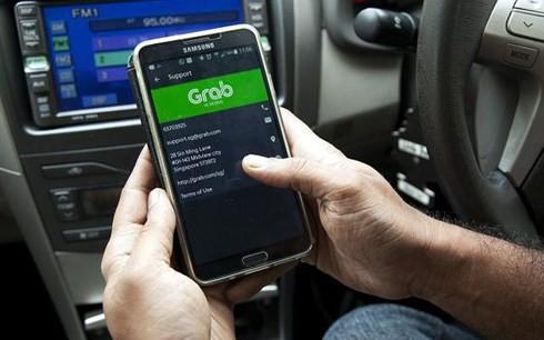 Taxi Grab có vốn pháp định 20 tỷ đồng nhưng lỗ lũy kế hơn 938 tỷ đồng.(Ảnh minh họa: KT)