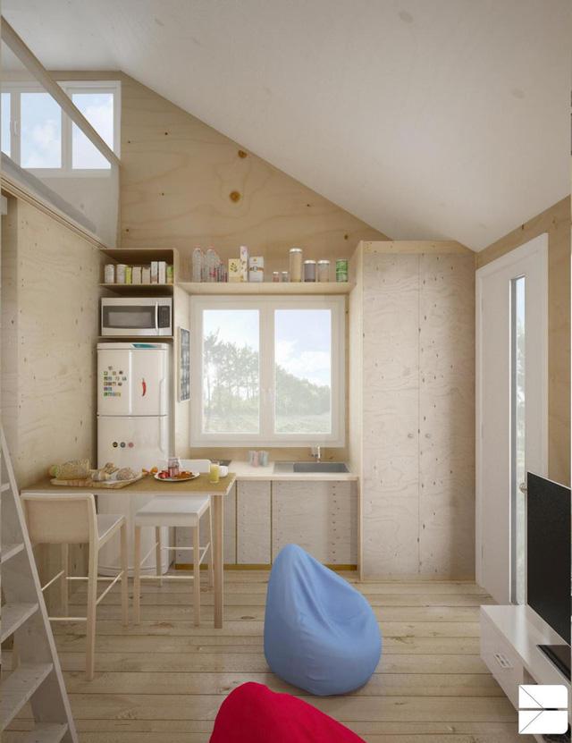 Dễ dàng nhận thấy trong nhà, chất liệu gỗ được sử dụng rộng khắp từ tường, trần cho đến sàn nhà và nội thất khiến nơi này trông ấm cúng mà rất thoáng đãng.