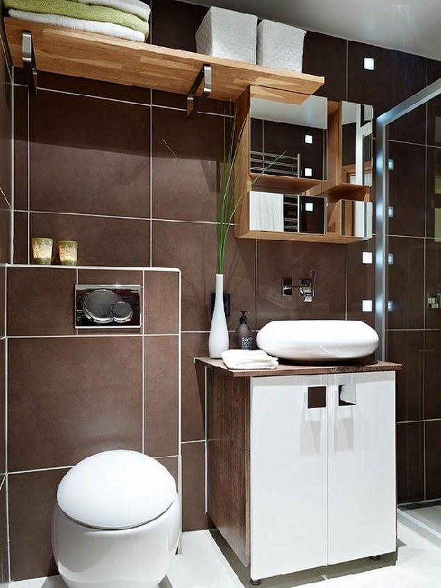 Phòng tắm nhỏ sạch đẹp với sự kết hợp hài hòa giữa hai gam màu nâu – trắng.