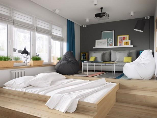 """Phòng khách được thiết kế đặc biệt với sàn gỗ được nâng cao hai bậc. Đây cũng chính là không gian nghỉ ngơi lý tưởng của chủ nhà với chiếc giường được """"giấu"""" bên dưới sàn nhà."""