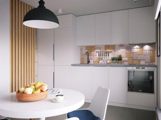 Khu vực bếp được thiết kế đơn giản với hệ tủ kệ màu trắng cùng tông màu với chiếc bàn ăn tròn tạo nên một không gian thoáng sáng và sạch sẽ. Căn hộ tuy nhỏ, nhưng mọi không gian chức năng đều được bố trí rất khoa học và tiện nghi mà không kém phần sang trọng.