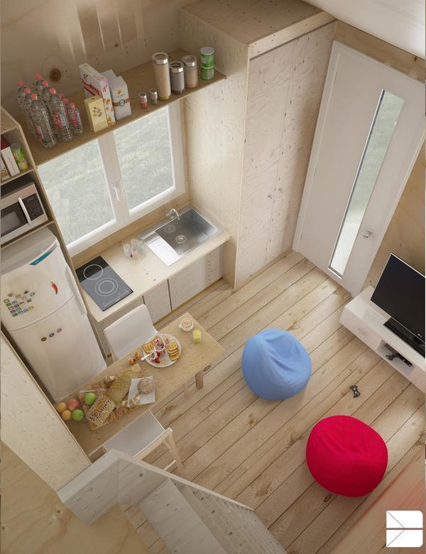 Toàn bộ nội thất trong nhà đều được thiết kế phù hợp với không gian. Bàn ăn có dạng gấp tiết kiệm diện tích, tủ bếp, bồn rửa và tủ lạnh được thiết kế trong một khối liên hoàn tiện dụng và gọn gàng.