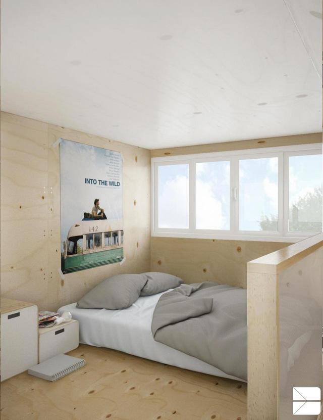 Không gian trên gác lửng là khu vực nghỉ ngơi với giường ngủ, tủ đầu giường được ngăn cách với tầng trệt bằng tấm kính mờ. Nhờ trần nhà cao và nội thất đơn giản mà khu vực này tuy đơn giản nhưng rất thư thái, phù hợp cho việc nghỉ ngơi.
