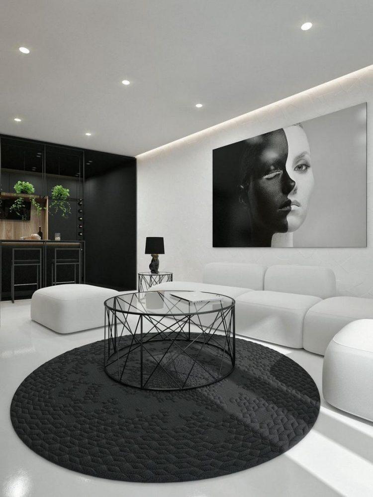 Bức chân dung lớn cũng với 2 tông màu đối lập đen- trắng thu hút mọi ánh nhìn của khách vào nhà.