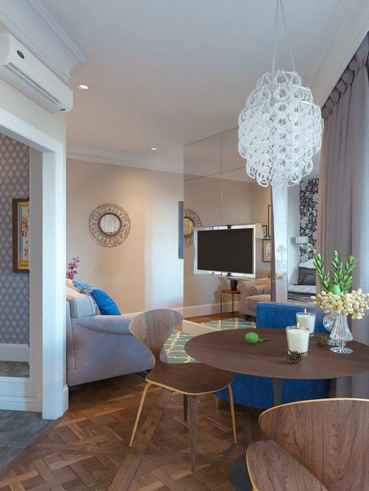 Sâu vào bên trong là phòng khách, bếp và khu vực nghỉ ngơi. Các khu vực chức năng được bố trí trong cùng một không gian mở khiến căn phòng có cảm giác rộng thoáng hơn.