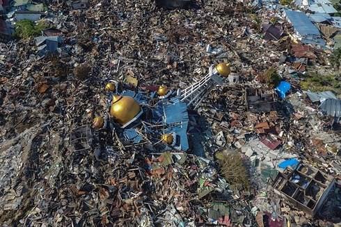 Cảnh khốn cùng của người dân Indonesia sau động đất, sóng thần - Ảnh 1.