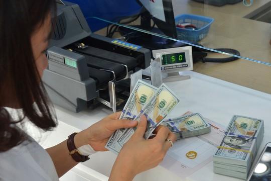 FED tăng lãi suất, tỉ giá USD/VNĐ vẫn ổn - Ảnh 1.