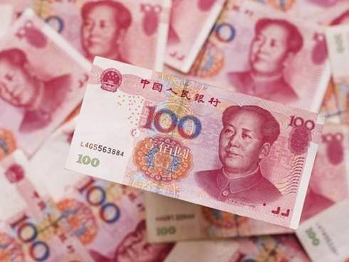 Đồng nhân dân tệ mất giá có tác động nhiều đến kinh tế Việt Nam? - Ảnh 1.