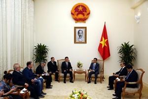 Phó Thủ tướng Vũ Đức Đam tiếp Chủ tịch Liên đoàn Cờ vua thế giới - Ảnh 1.