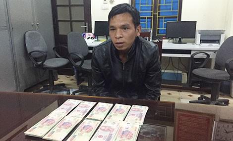 Bắt đối tượng rao bán tiền Việt Nam giả qua mạng zalo  - Ảnh 1.
