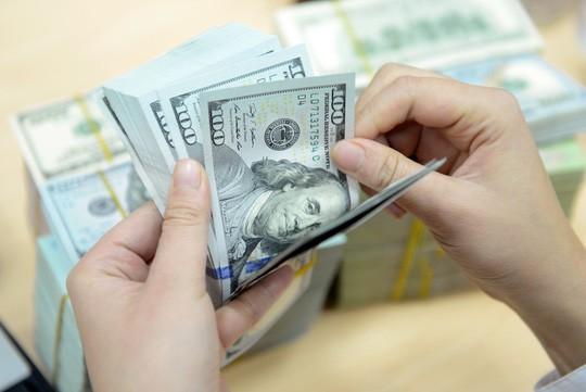 Mỹ tăng lãi suất, tỉ giá tại Việt Nam biến động không đáng kể - Ảnh 1.