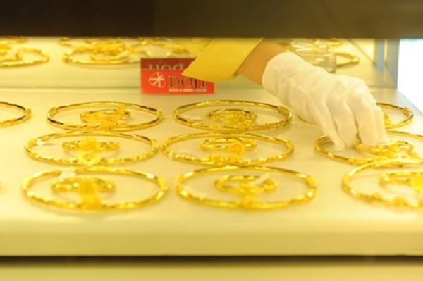 Nhu cầu mua vàng chững khiến thị trường trầm lắng - Ảnh 1.