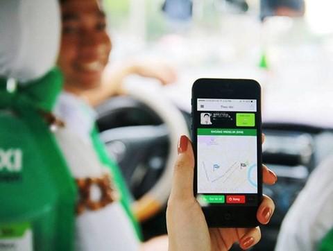 Sở Giao thông Vận tải Hà Nội kiến nghị coi Uber, Grab là một dạng kinh doanh taxi - Ảnh 1.
