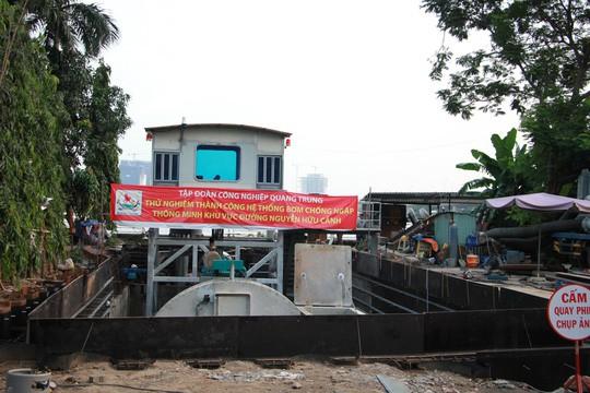 Chưa chốt giá thuê máy bơm chống ngập đường Nguyễn Hữu Cảnh - Ảnh 1.