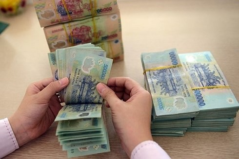Chưa thu thuế thu nhập cá nhân từ lãi tiền gửi tại ngân hàng - Ảnh 1.