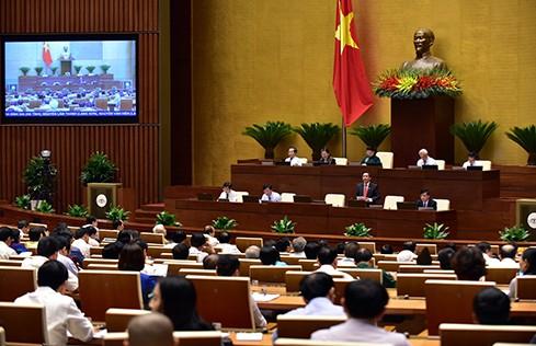 Bộ trưởng Nguyễn Văn Thể trả lời chất vấn - Ảnh 2.