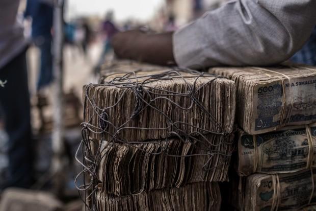 Bị cô lập, chìm trong siêu lạm phát đến nỗi dân phải chở tiền bằng xe cút kít nhưng xứ sở châu Phi này lại đang đứng đầu thế giới trên phương diện xã hội không tiền mặt - Ảnh 4.