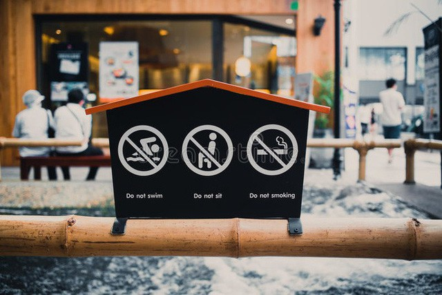 Nhật Bản: Mất cả gia tài nếu hút thuốc lá nơi công cộng - Ảnh 2.