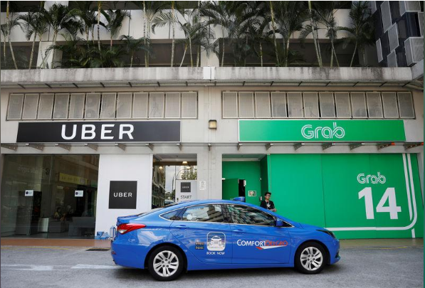 Singapore đề xuất hủy vụ sáp nhập của Uber và Grab - Ảnh 1.