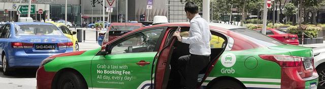 Cho rằng thỏa thuận Grab-Uber gây thiệt hại cho người tiêu dùng, Singapore đề xuất các hình phạt mạnh tay - Ảnh 1.