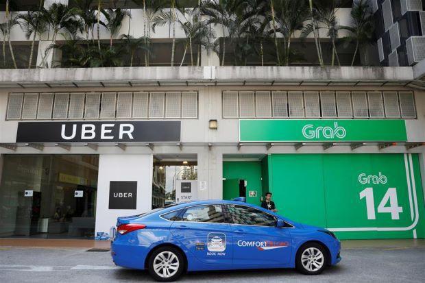 Cho rằng thỏa thuận Grab-Uber gây thiệt hại cho người tiêu dùng, Singapore đề xuất các hình phạt mạnh tay - Ảnh 2.