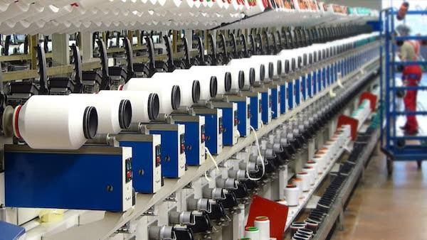 Thêm nhiều dự án triệu USD đầu tư vào nhà máy sản xuất nguyên phụ liệu ngành may - Ảnh 1.