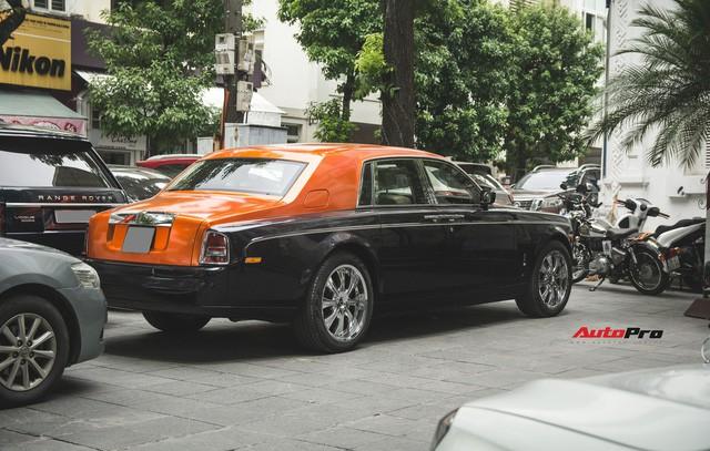 Chiếc Rolls-Royce Phantom tại Hà Nội đổi màu nhanh như tắc kè: Vừa hết tím mộng mơ lại đến cam cá tính - Ảnh 11.