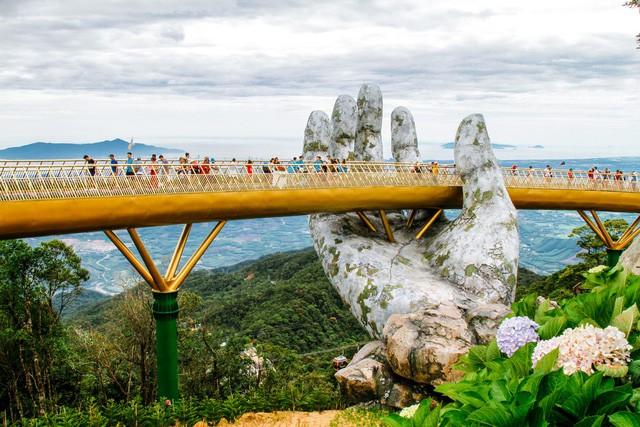 Cầu Vàng tại Đà Nẵng lọt vào Top 100 điểm đến tuyệt vời nhất thế giới - Ảnh 1.