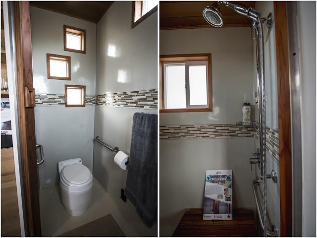 Nhà vệ sinh thoáng sạch với nhiều cửa sổ nhỏ.