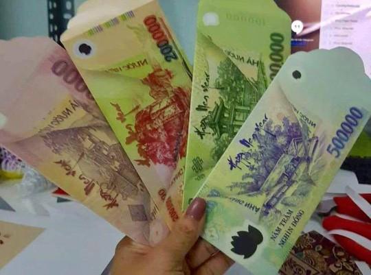 Xếp tiền thành cây tài lộc, in lên bao lì xì có thể bị phạt tới 80 triệu đồng - Ảnh 1.