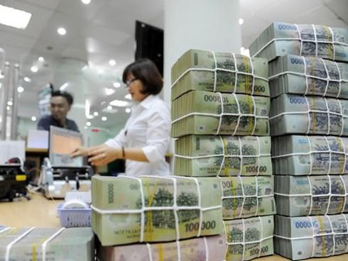 Hệ thống ngân hàng thương mại đang thừa tiền - Ảnh 1.