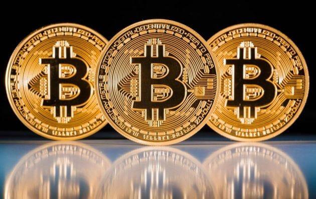 Thị trường tiền ảo 'cháy đỏ', Bitcoin lùi sâu về 7.500 USD - Ảnh 1.
