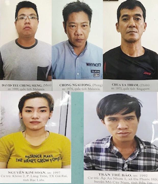 Thủ đoạn rút trộm tiền tỷ ở các trụ ATM của nhóm tội phạm xuyên quốc gia - Ảnh 1.