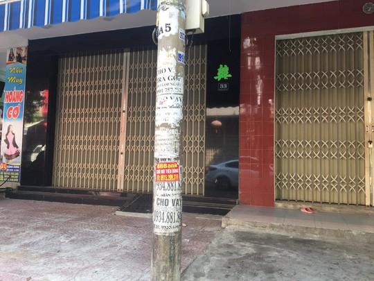 Nhếch nhác tờ rơi cho vay nặng lãi tràn lan trên đường phố Đà Nẵng  - Ảnh 7.