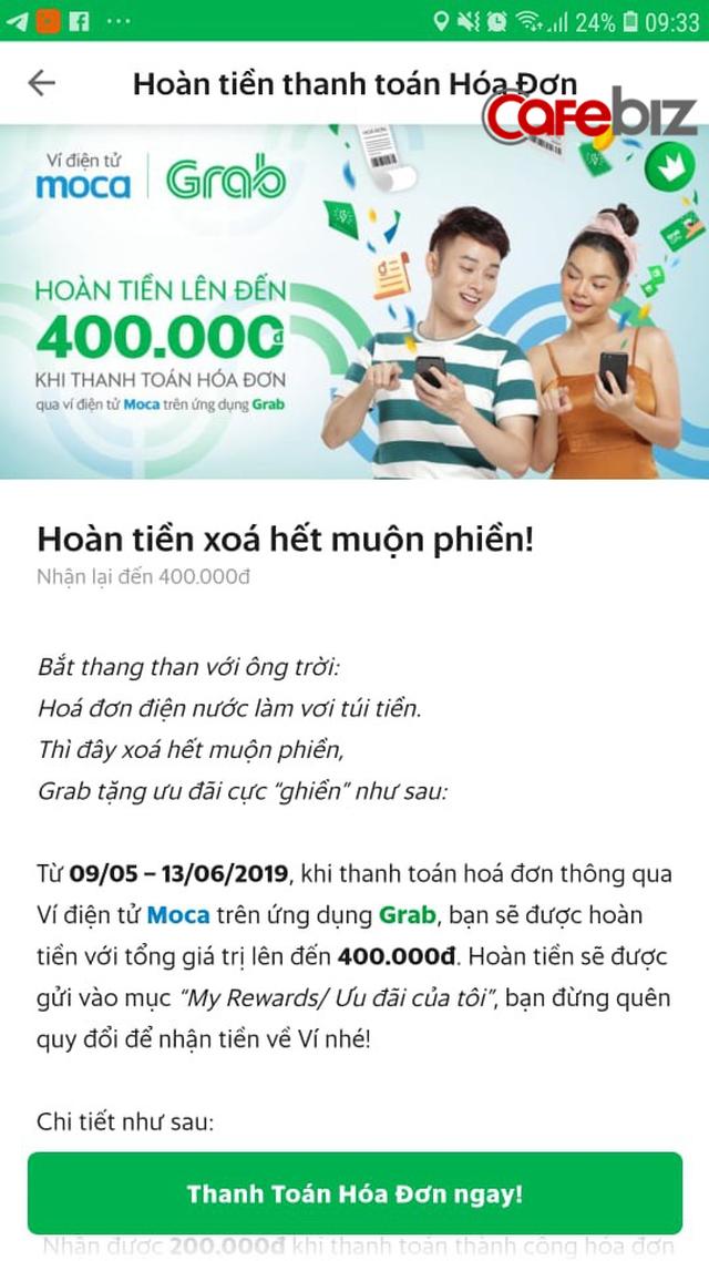 Grab vừa cho Momo thấy như thế nào là mạnh vì gạo, bạo vì tiền: Hóa đơn tiền điện 500.000 đồng, nhưng nộp qua Grabpay by Moca chỉ mất 400.000 đồng - Ảnh 1.