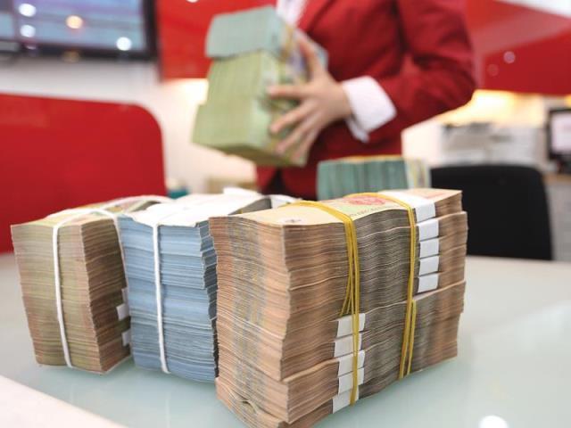 Lãi suất đồng Việt Nam từ nay đến cuối năm có tăng? - Ảnh 1.