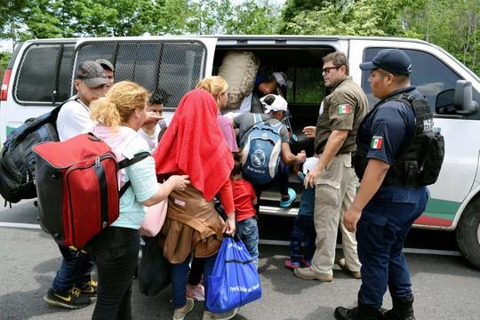 Mỹ - Mexico căng vì người di cư - Ảnh 1.