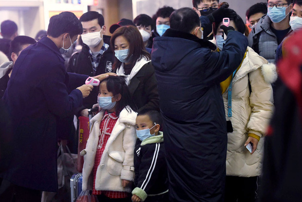 Trung Quốc bất ngờ tuyên bố không phải ai nhiễm Virus Corona cũng đều có dấu hiệu sốt - Ảnh 1.