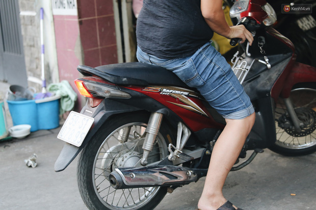 Dịch vụ giữ xe máy xuyên Tết cho người dân rời Sài Gòn về quê hốt tiền triệu mỗi ngày - Ảnh 5.