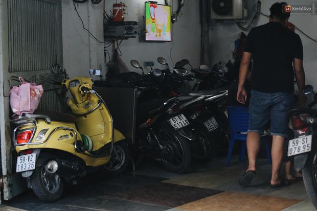 Dịch vụ giữ xe máy xuyên Tết cho người dân rời Sài Gòn về quê hốt tiền triệu mỗi ngày - Ảnh 8.