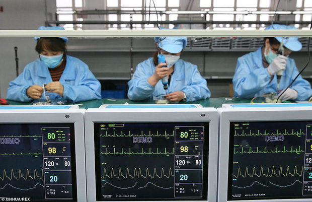 Virus corona: Bên trong bệnh viện dã chiến 1.000 giường vừa được xây dựng thần tốc tại Vũ Hán - Ảnh 11.