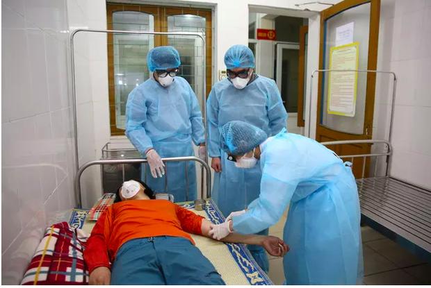 Bộ Y tế: Không có triệu chứng ho - sốt nhưng có 1 trong 6 yếu tố sau vẫn phải cách ly - Ảnh 1.
