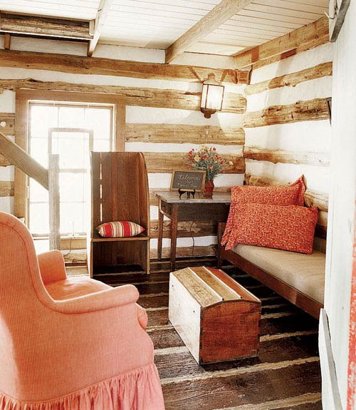 Colorful Living Room In A Log Cabin