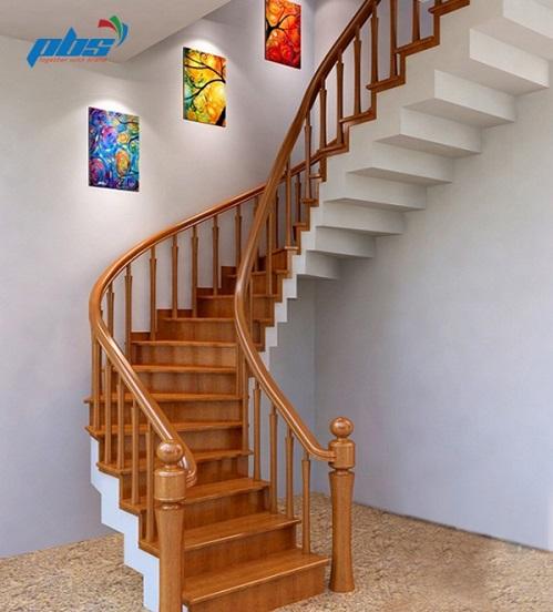 Những mẫu cầu thang gỗ đẹp dạng uốn tròn như thế này sẽ giúp bạn tiết kiệm không gian cho nhà nhỏ một cách đáng kể đấy.